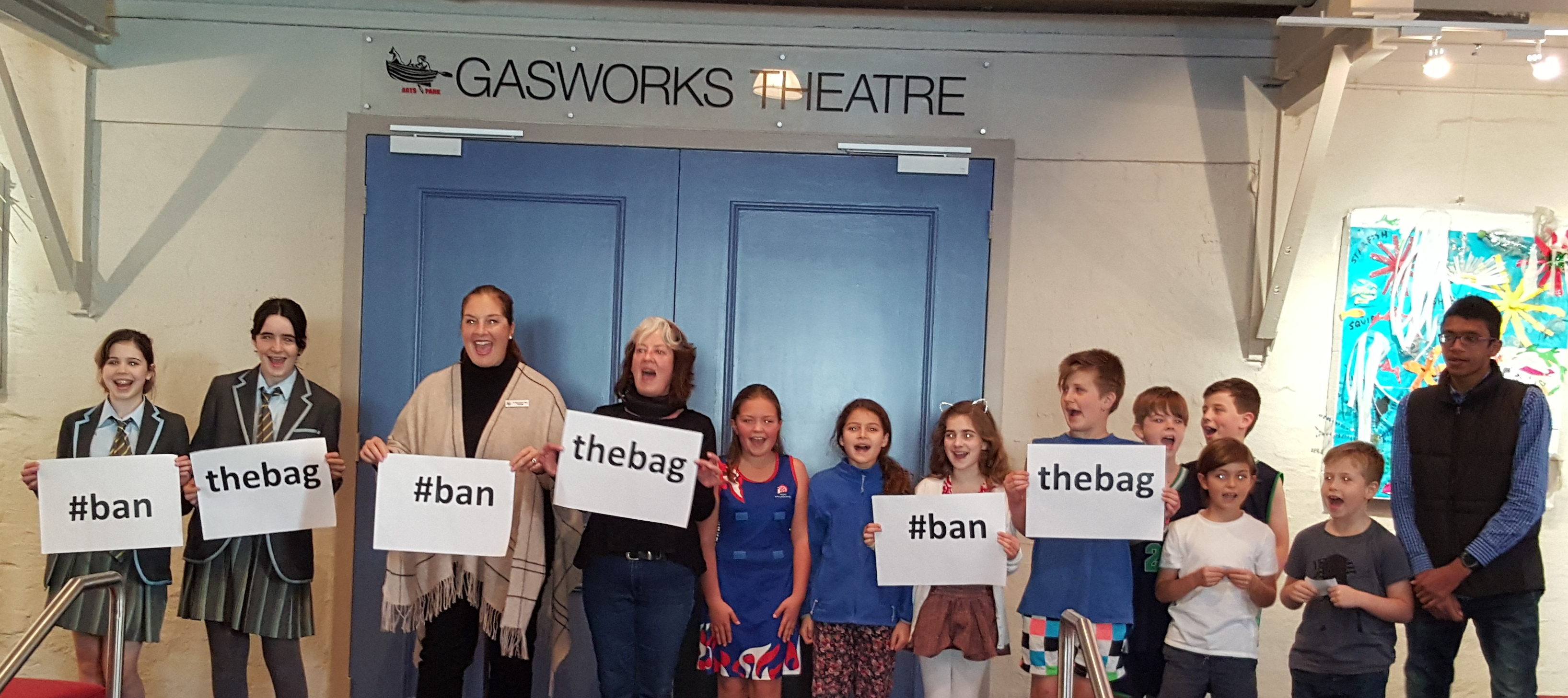 Port Phillip mayor Bernadene Voss with local children opening the Creatures of the Bay exhibition with a 'ban the bag' demonstration.
